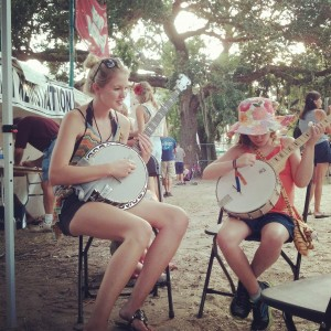 Our good friend and Deering artist Ashley Campbell, of Victoria Ghost came down and joined us in St. Augustine. Here she is giving a lesson to a young lady, bit by the banjo bug, who didn't want to put it down!