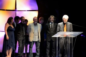 """Deering artist Terry Bacoum accepting the IBMA Award for Recorded Event of The Year of """"What'll I Do"""" which included Sam Bush, Jerry Douglas, Wyatt Rice, Steve Bryant, Buddy Melton, Cindy Baucom, Ed Lowe, John Boy and Billy label."""